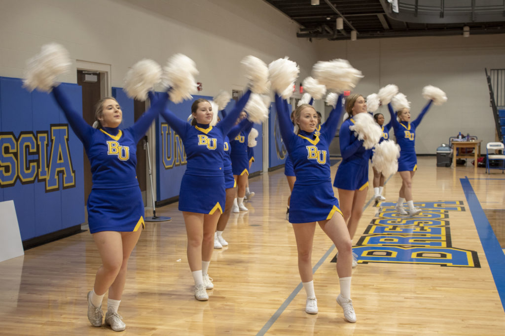 Cheer team performing during a home basketball game