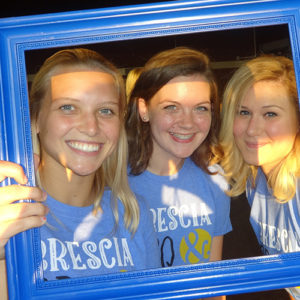 Students holding a blue frame